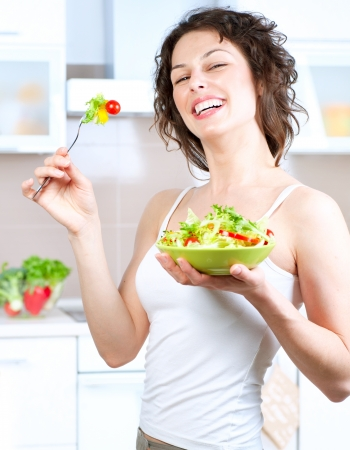 salad fork: Diet  Healthy Young Woman Eating Vegetable Salad