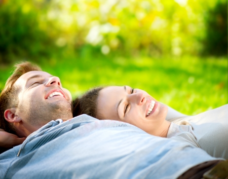 Park  Young Couple Lying on Grass Outdoor Stock Photo - 15501067