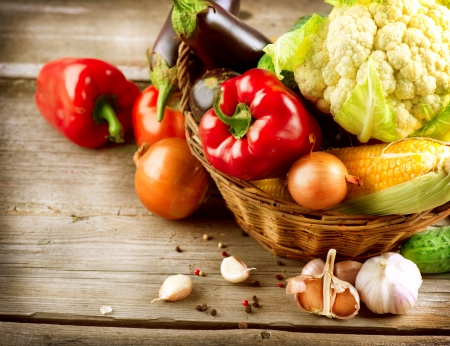 food table: Healthy Organic Vegetables on a Wood Background  Stock Photo
