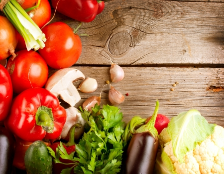 Healthy Organic Vegetables on a Wood Background Stock Photo - 15302503
