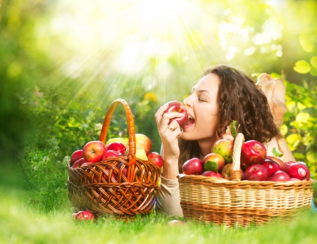 Beautiful Girl Eating Organic Apple in the Orchard  Stock Photo - 15512918
