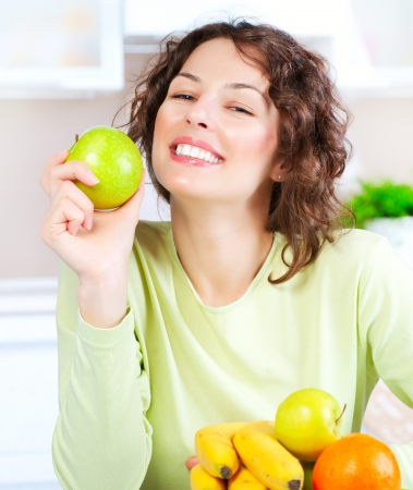 Diet  Happy Young Woman Eating Fresh Fruit  Stock Photo - 15353308