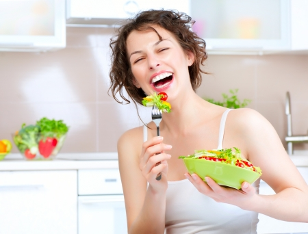 eating: Diet  Beautiful Young Woman Eating Vegetable Salad
