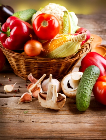 abstract art vegetables: Healthy Organic Vegetables on a Wood Background  Stock Photo