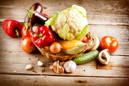 organic background: Healthy Organic Vegetables on a Wood Background  Stock Photo
