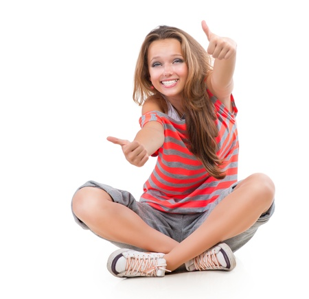 finger teen: Happy Teen Girl showing Thumbs up isolated one white