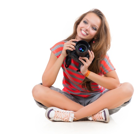 look at camera: Teenage Girl with Professional Camera  Isolated on white  Stock Photo