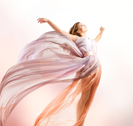 Beautiful Girl in blowing Dress Flying photo