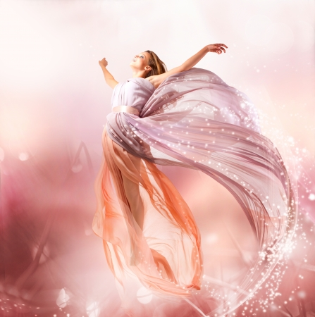 Fairy  Beautiful Girl in Blowing Dress Flying  Magic  photo