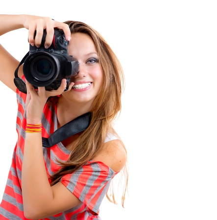 look at camera: Teenage Girl with Professional Photo Camera  Isolated on white