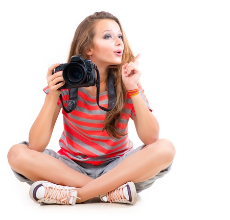 photographers: Teenage Girl with Professional Photo Camera  Isolated on white