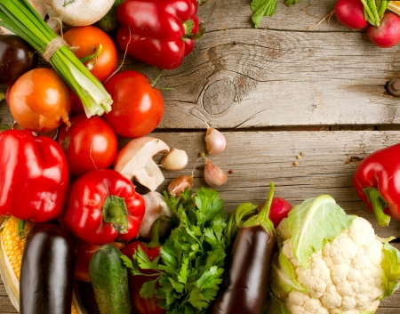 organic background: Healthy Organic Vegetables on the Wooden Background Stock Photo