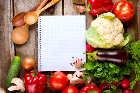 Open Notebook and Fresh Vegetables Background  Diet photo