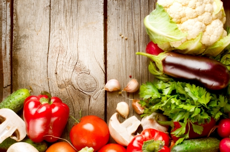 food table: Healthy Organic Vegetables on the Wooden Background Stock Photo