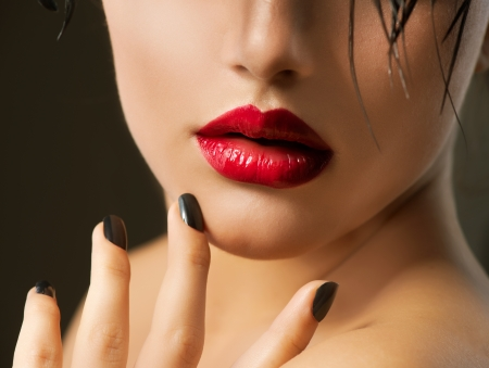 Fashion Girl Closeup  Red Lips And Black Nails  Beautiful Makeup photo