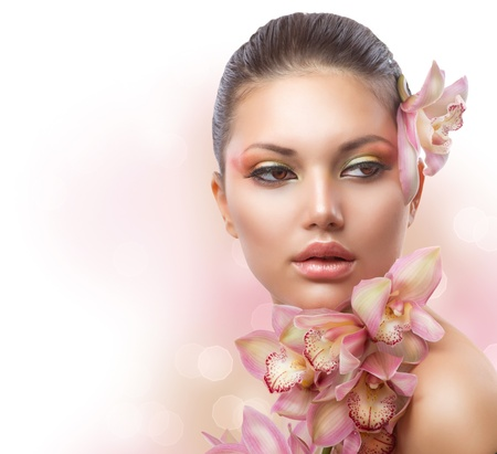 naked young woman: Beautiful Girl With Orchid Flowers  Perfect Make-up