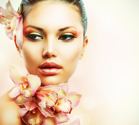 naked young woman: Beautiful Girl With Orchid Flowers  Beauty Woman Face