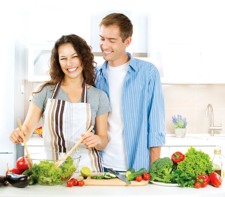 people cooking: Happy Couple Cooking Together  Dieting  Healthy Food  Stock Photo