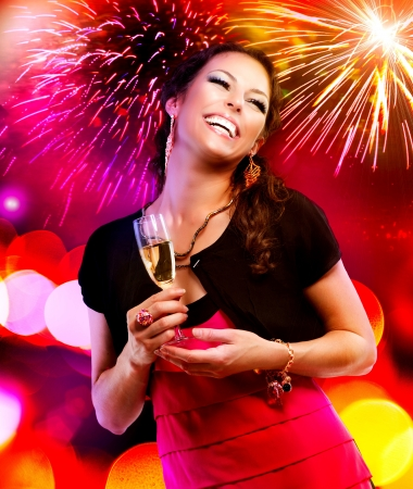 firework: Beautiful Girl with Holiday Makeup Holding Glass of Champagne  Stock Photo