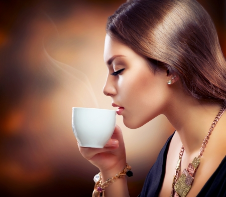 hot girl: Beautiful Girl Drinking Tea or Coffee  Stock Photo