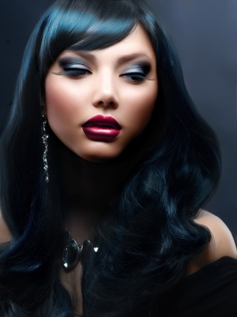 Beautiful Woman With Black Hair and Holiday Professional Makeup  photo