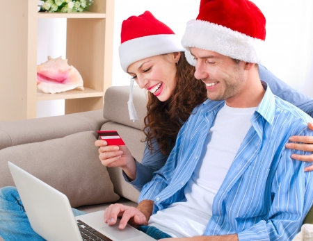 Young couple with laptop and credit card buying online Stock Photo - 16052405