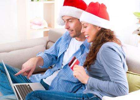 Couple with credit card buying online  Christmas Shopping Stock Photo - 16052411
