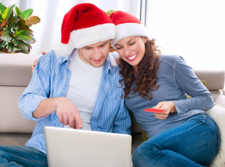Christmas Online Shopping  Couple Using Credit Card to E-Shop Stock Photo - 16052412