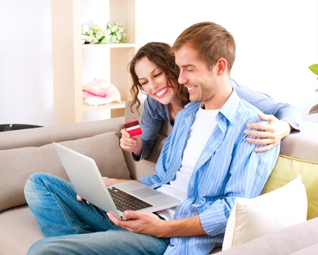 credit card purchase: Online Shopping  Couple Using Credit Card to Internet Shop