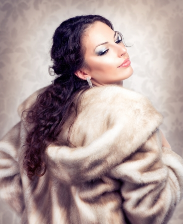 Fashion Beautiful Woman in Luxury Fur Mink Coat  photo