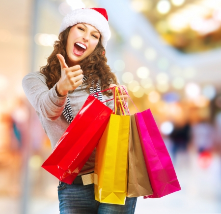 gift bag: Christmas Shopping  Girl With Bags in Shopping Mall Stock Photo