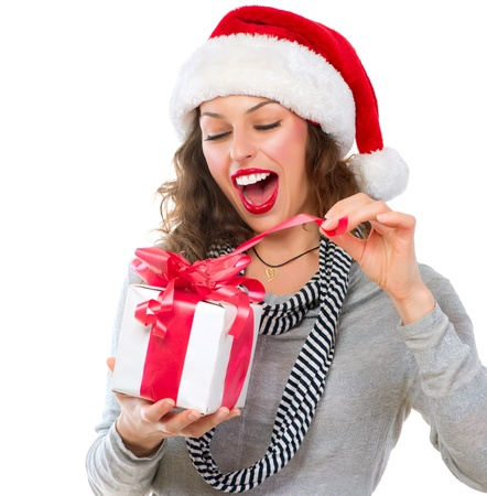 Beautiful Young Woman Opening Christmas Gift Box  Surprised Girl  photo