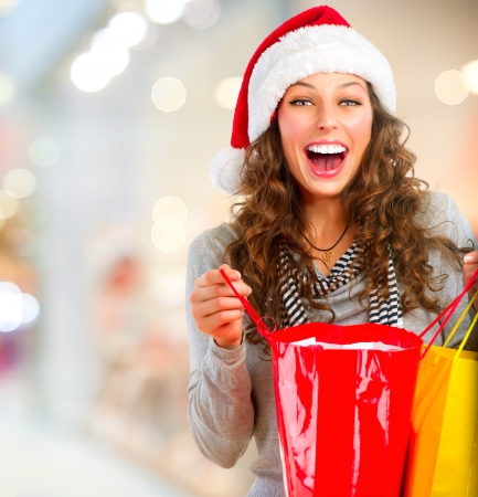 christmas shopping: Christmas Shopping  Happy Woman with Bags in Mall  Sales  Stock Photo