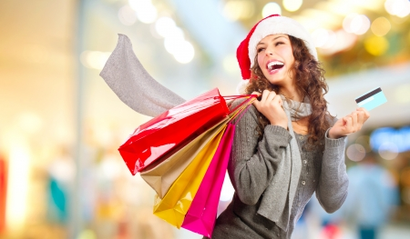 christmas shopping bag: Christmas Shopping  Girl With Credit Card In Shopping Mall Sales Stock Photo
