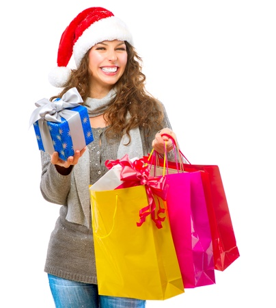 Christmas Shopping  Girl With Bags isolated on White photo