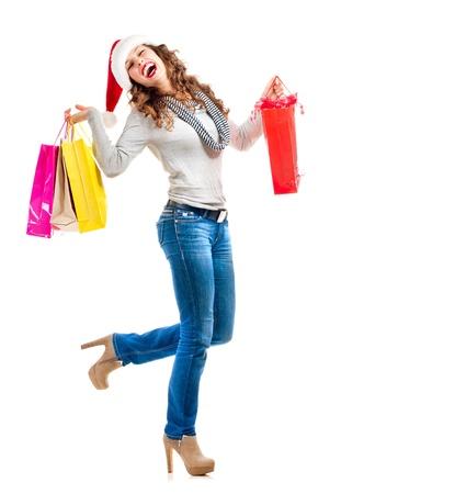faire les courses: Fille avec des sacs � provisions Ventes Achats de No�l Banque d'images