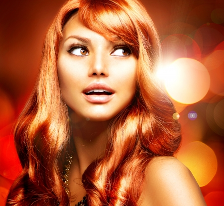 Beautiful Girl With Healthy Long Red Hair  photo