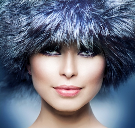 Fashion  Beautiful Girl in Fur Hat  Winter Woman  photo