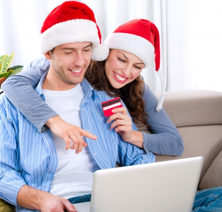 buying online: Christmas Online Shopping  Couple Using Credit Card to E-Shop
