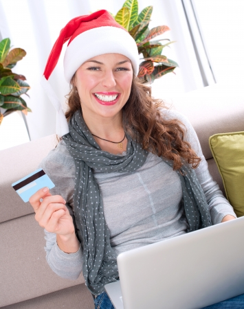 Christmas Online Shopping  Girl Using Credit Card to E-Shop  photo