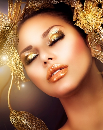 make up model: Fashion Glamour Makeup  Holiday Gold Makeup  Stock Photo