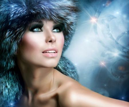 winter woman: Winter Christmas Woman Portrait  Beautiful Girl in Fur Hat  Stock Photo