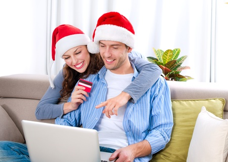 business christmas: Christmas Online Shopping  Couple Using Credit Card to E-Shop