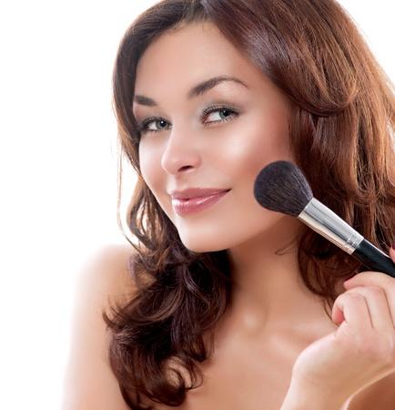 makeup applying: Beautiful Young Woman Applying Makeup Stock Photo