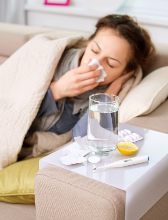 sniff: Sick Woman  Flu  Woman Caught Cold  Sneezing into Tissue  Stock Photo