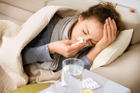 Sick Woman  Flu  Woman Caught Cold  Sneezing into Tissue  Stock Photo
