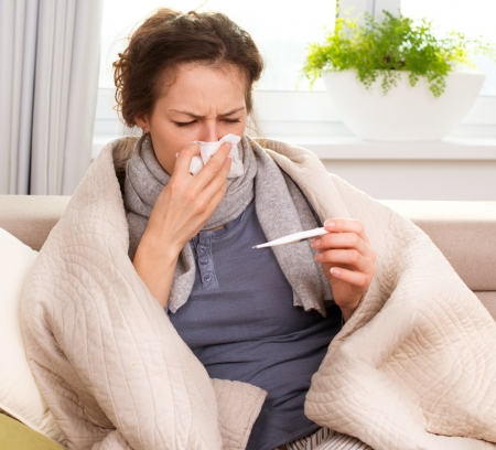 cold woman: Sick Woman  Flu  Woman Caught Cold  Sneezing into Tissue  Stock Photo