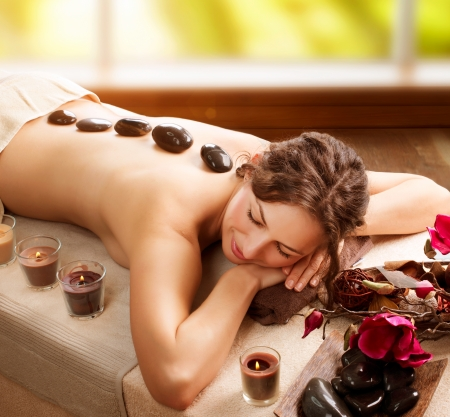 woman in spa: Stone Massage  Day Spa  Spa Salon  Stock Photo