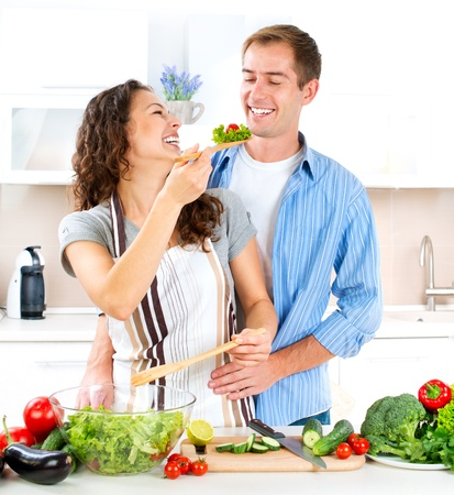 Happy Couple Cooking Together  Dieting  Healthy Food Stock Photo - 16313846
