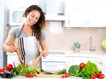 Young Woman Cooking  Healthy Food - Vegetable Salad  photo